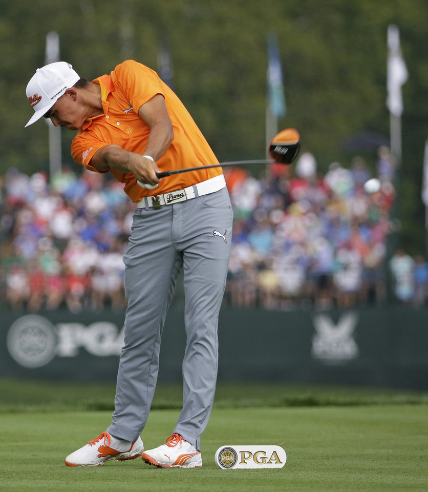 Photo - Rickie Fowler hits his tee shot on the fifth hole during the final round of the PGA Championship golf tournament at Valhalla Golf Club on Sunday, Aug. 10, 2014, in Louisville, Ky. (AP Photo/David J. Phillip)