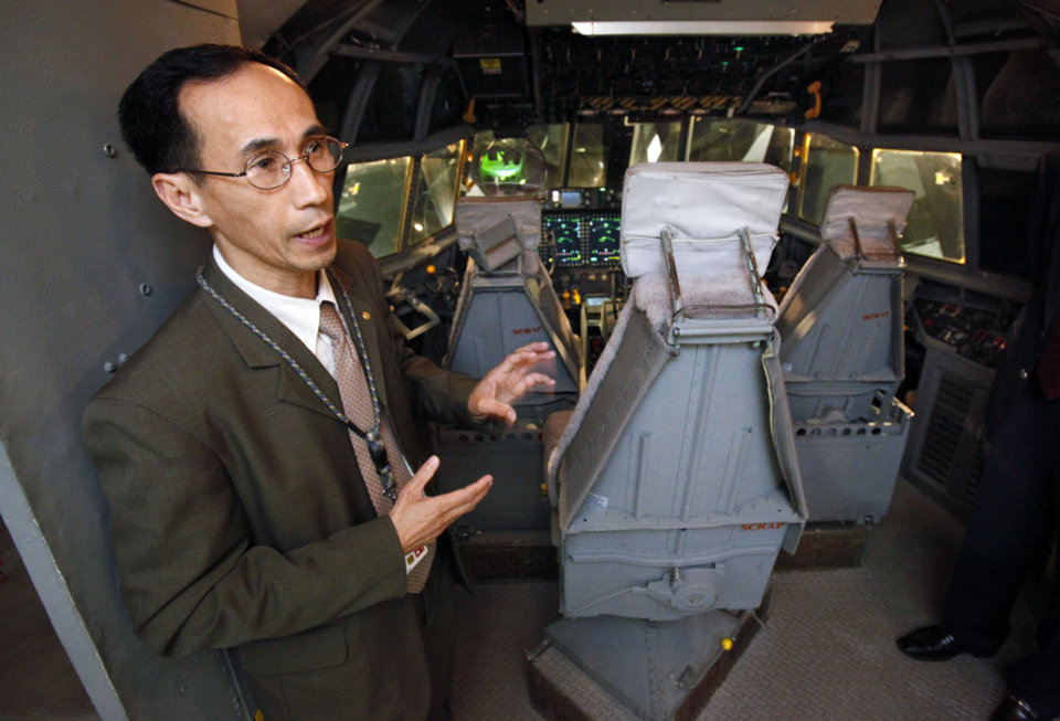 Liem Vu, mission systems manager, gives a tour Thursday of a simulator inside Boeing�s newest office building  in Oklahoma City.   Photo by Steve Sisney, The Oklahoman