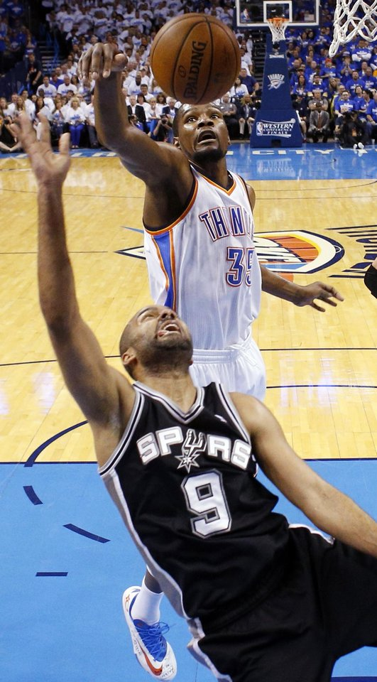 Photo - Oklahoma City's Kevin Durant (35) blocks the shot of San Antonio's Tony Parker (9) in the first half during Game 4 of the Western Conference Finals in the NBA playoffs between the Oklahoma City Thunder and the San Antonio Spurs at Chesapeake Energy Arena in Oklahoma City, Tuesday, May 27, 2014. Photo by Nate Billings, The Oklahoman