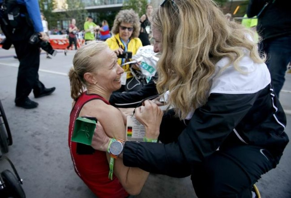 Photo -  Stephanie Andre, who won the women's race in record time Sunday, speaks with former record holder Camille Herron after finishing the Oklahoma City Memorial Marathon. [Bryan Terry/The Oklahoman]