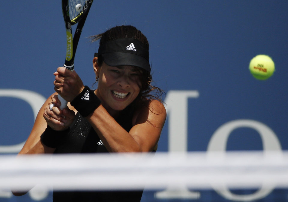 Photo - Ana Ivanovic, of Serbia, returns a shot against Alison Riske, of the United States, during the opening round of the 2014 U.S. Open tennis tournament, Tuesday, Aug. 26, 2014, in New York. (AP Photo/Kathy Willens)