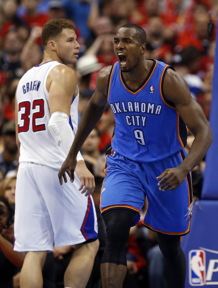 Oklahoma City's Serge Ibaka (9) celebrates a basket in front of Los Angeles' Blake Griffin (32) during Game 3 of the Western Conference semifinals in the NBA playoffs between the Oklahoma City Thunder and the Los Angeles Clippers at the Staples Center in Los Angeles, Friday, May 9, 2014. Photo by Nate Billings, The Oklahoman
