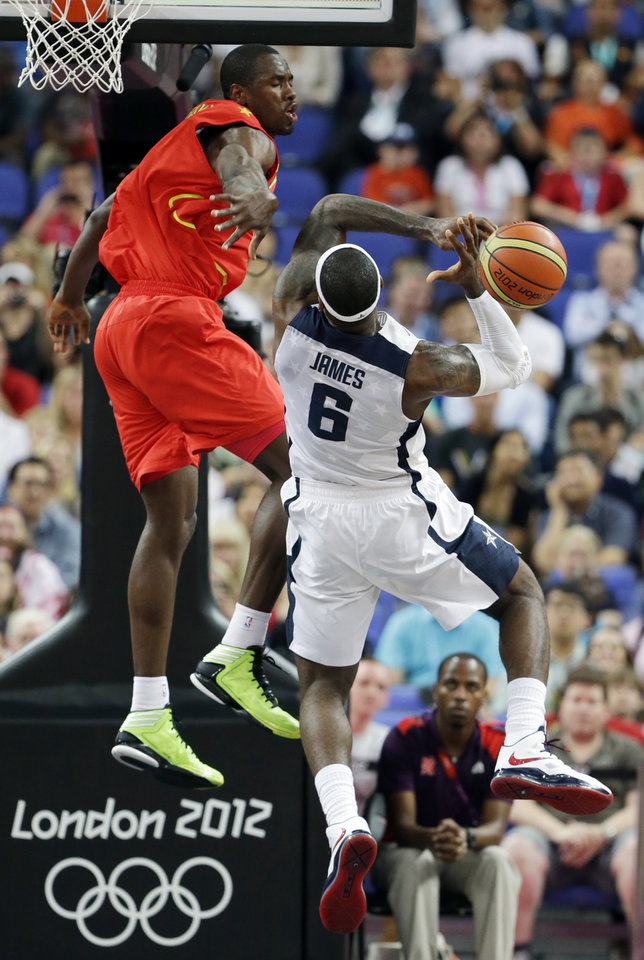 Spain's Serge Ibaka blocks a shot by United States' LeBron James during a men's gold medal basketball game at the 2012 Summer Olympics, Sunday, Aug. 12, 2012, in London. (AP Photo/Eric Gay)