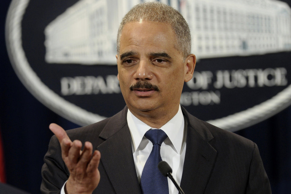 Photo - Attorney General Eric Holder announces a $1.2 billion settlement with Toyota over its disclosure of safety problems, Wednesday, March 19, 2014, during a news conference at the Justice Department in Washington. (AP Photo/Susan Walsh)