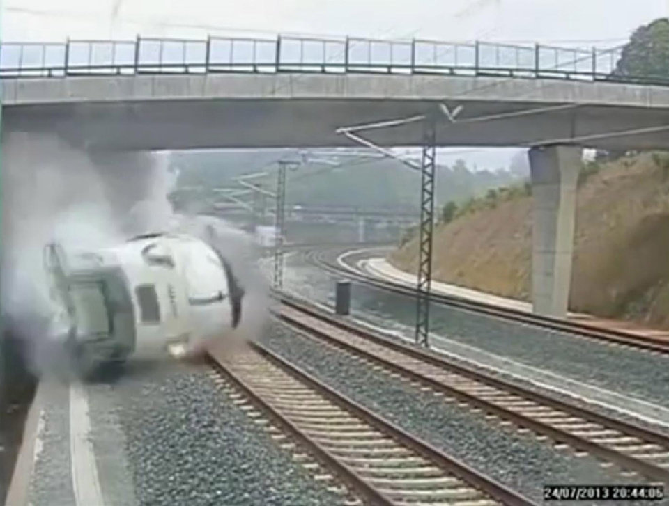 Photo - This image taken from security camera video shows a train derailing in Santiago de Compostela, Spain, on Wednesday, July 24, 2013. Spanish investigators tried to determine Thursday why a passenger train jumped the tracks and sent eight cars crashing into each other just before arriving in this northwestern shrine city on the eve of a major Christian religious festival, killing at least 77 people and injuring more than 140. (AP Photo)