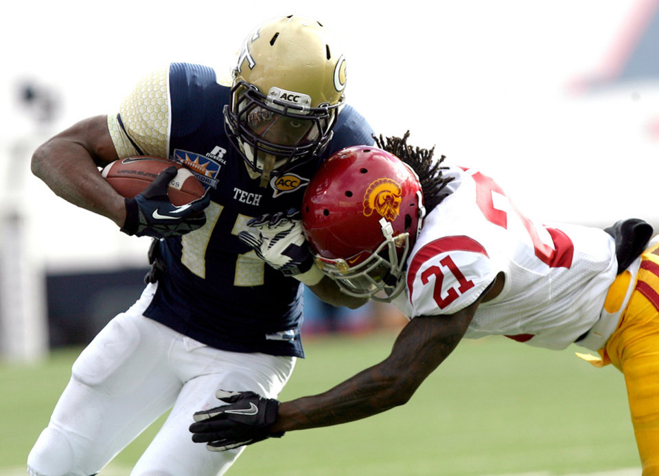 Georgia Tech running back Orwin Smith, left, rushes in for a touchdown against Southern California's Nickell Robey during the Sun Bowl NCAA college football game, Monday, Dec. 31, 2012, in El Paso, Texas. Georgia Tech won 21-7. (AP Photo/Mark Lambie)
