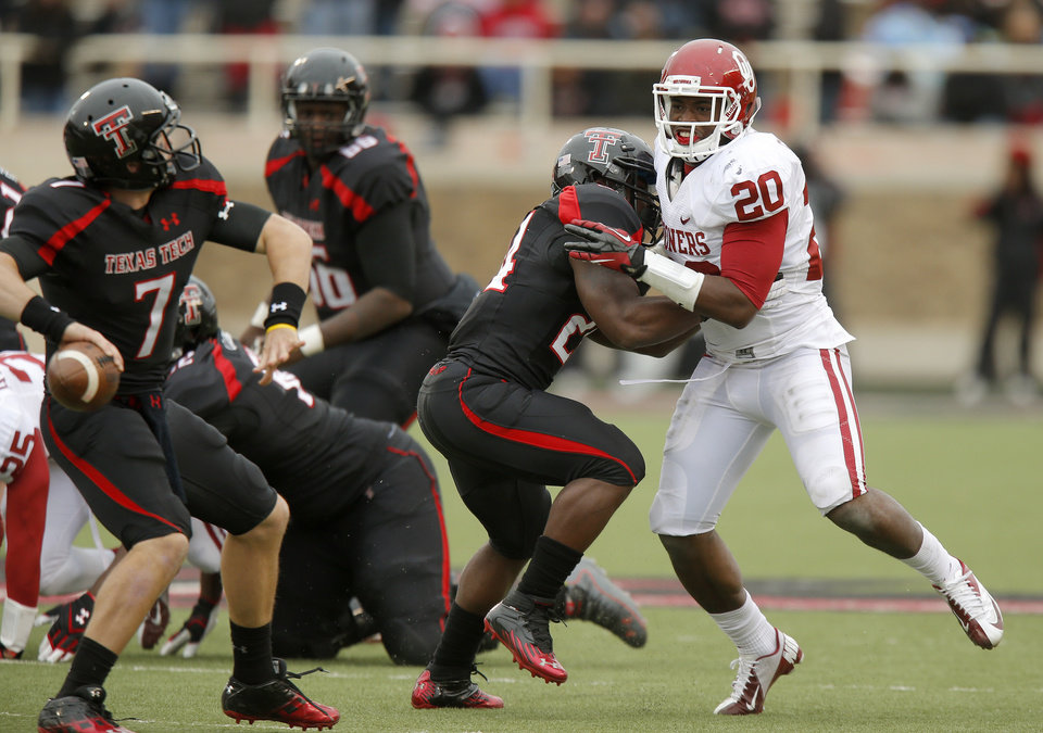 Photo - Oklahoma's Frank Shannon (20) tries to get past Texas Tech's Eric Stephens Jr. (24) during a college football game between the University of Oklahoma (OU) and Texas Tech University at Jones AT&T Stadium in Lubbock, Texas, Saturday, Oct. 6, 2012. Oklahoma won 41-20. Photo by Bryan Terry, The Oklahoman