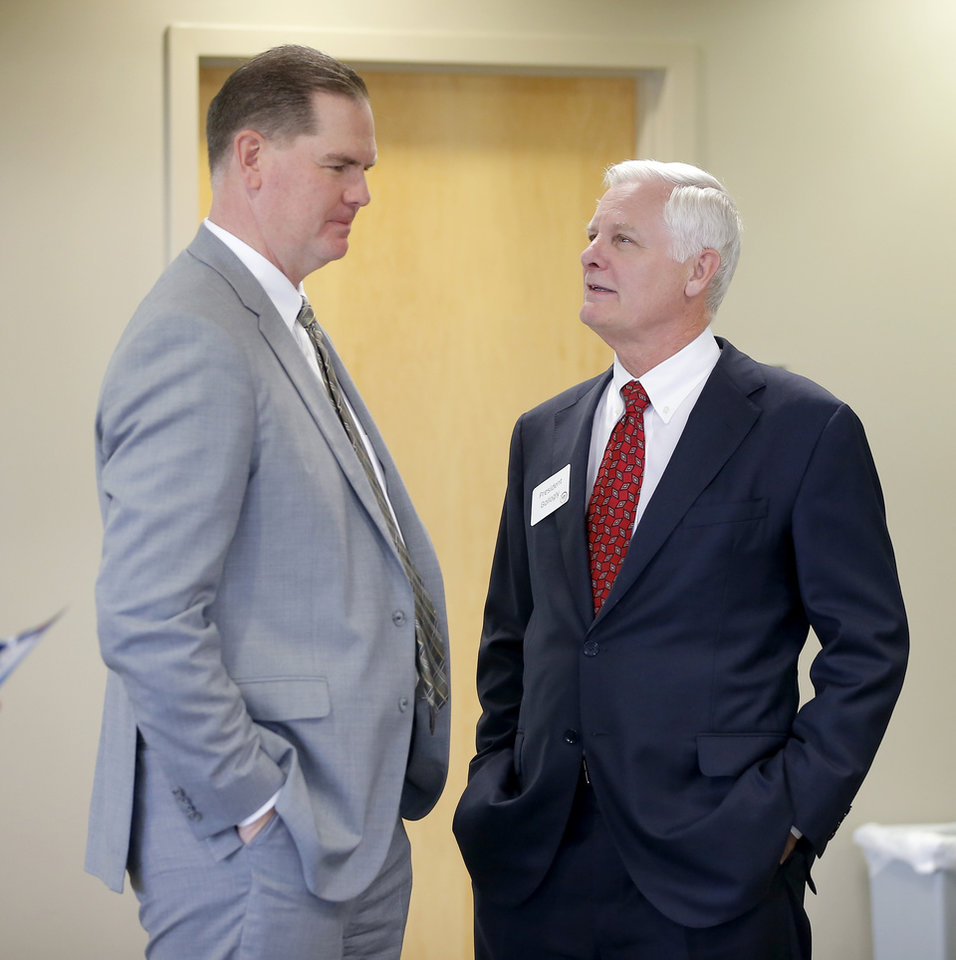 Photo - Jim Gallogly, right, University of Oklahoma president, speaks with Oklahoma City Public Schools Superintendent Sean McDaniel during an event at the University of Oklahoma's K20 Center for Educational and Community Renewal on Wed., Nov. 7, 2018. The center received three Gaining Early Awareness and Readiness for Undergraduate Programs grants sponsored by the U.S. Department of Education. Photo by Bryan Terry, The Oklahoman