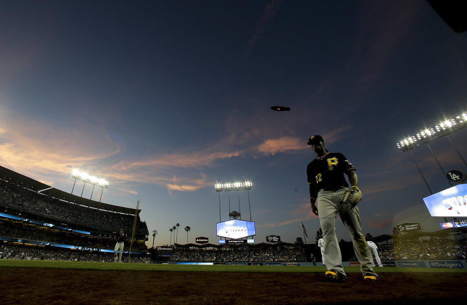 Photo - Pittsburgh Pirates center fielder Andrew McCutchen walks off the field after the eighth inning of a baseball game against the Los Angeles Dodgers in Los Angeles, Sunday, June 1, 2014. (AP Photo/Chris Carlson)