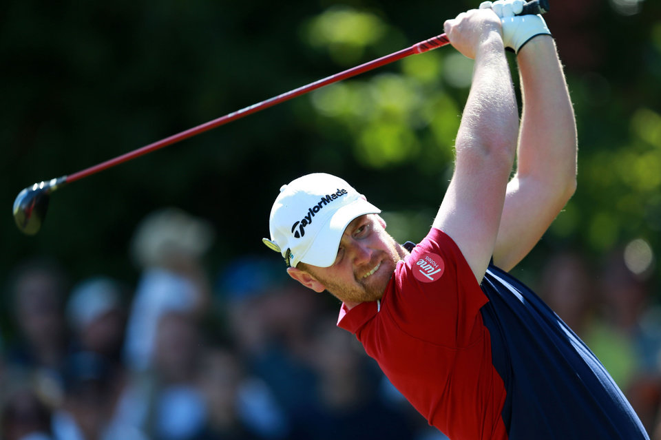 Photo - John Singleton of England tees off from the fifth hole during the first day of the British Open Golf championship at the Royal Liverpool golf club, Hoylake, England, Thursday, July 17, 2014. (AP Photo/PA, David Davies) UNITED KINGDOM OUT, NO SALES, NO ARCHIVE