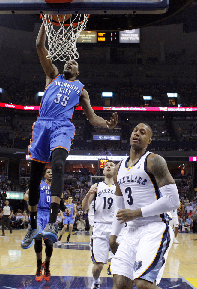 Oklahoma City's Kevin Durant (35) dunks beside Memphis' Beno Udrih (19) and James Johnson (3) during Game 6  in the first round of the NBA playoffs between the Oklahoma City Thunder and the Memphis Grizzlies at FedExForum in Memphis, Tenn., Thursday, May 1, 2014. Oklahoma City won 104-84. Photo by Bryan Terry, The Oklahoman