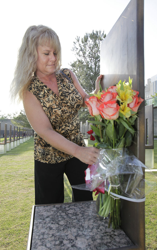 Dawn Mahan places flowers on the chair for her mother Frances Williams before the Day of Remembrance Ceremony, Tuesday, April 19, 2011.  This was the 16th annual Oklahoma City Bombing Memorial ceremony.   Photo by David McDaniel, The Oklahoman