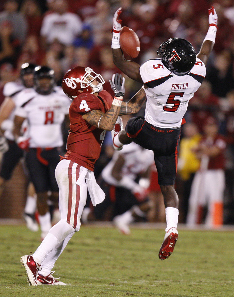 Photo - Texas Tech's Tre' Porter (5) intercepts a pass beside Oklahoma's Kenny Stills (4) during the college football game between the University of Oklahoma Sooners (OU) and the Texas Tech University Red Raiders (TTU) at Gaylord Family-Oklahoma Memorial Stadium in Norman, Okla., Saturday, Oct. 22, 2011. Photo by Bryan Terry, The Oklahoman