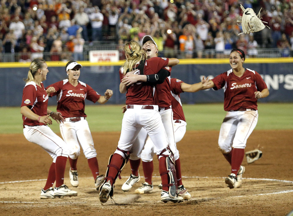 Oklahoma celebrates their championship win following the Women's College World Series softball game between Oklahoma and Tennessee at ASA Hall of Fame Stadium in Oklahoma City,Tuesday, June, 4, 2013. Photo by Sarah Phipps, The Oklahoman