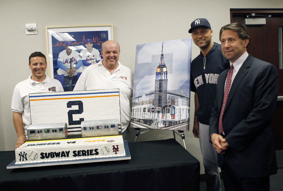 Photo - From left, cake designers Joe Faugno and Mauro Castano pose with New York Yankees shortstop Derek Jeter and New York Mets Chief Operating Officer Jeff Wilpon after the Mets presented Jeter with a cake designed for the final game of the Subway Series before a baseball game between the Yankees and the Mets in New York, Thursday, May 15, 2014. (AP Photo/Kathy Willens)