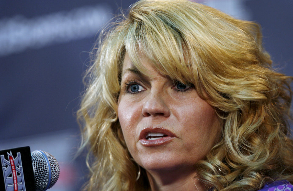 Photo - Oklahoma coach Sherri Coale speaks during the Big 12 Conference women's basketball media day, Wednesday, Oct. 19, 2011, in Kansas City, Mo. (AP Photo/The Kansas City Star, Rich Sugg) ORG XMIT: MOKAS302