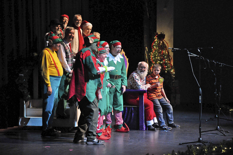 Photo - Members of OK Chorale perform a skit with The Grinch during their Christmas show Saturday at Putnam City West High School. Photo by M. Tim Blake, For The Oklahoman.  TIM BLAKE - TIM BLAKE