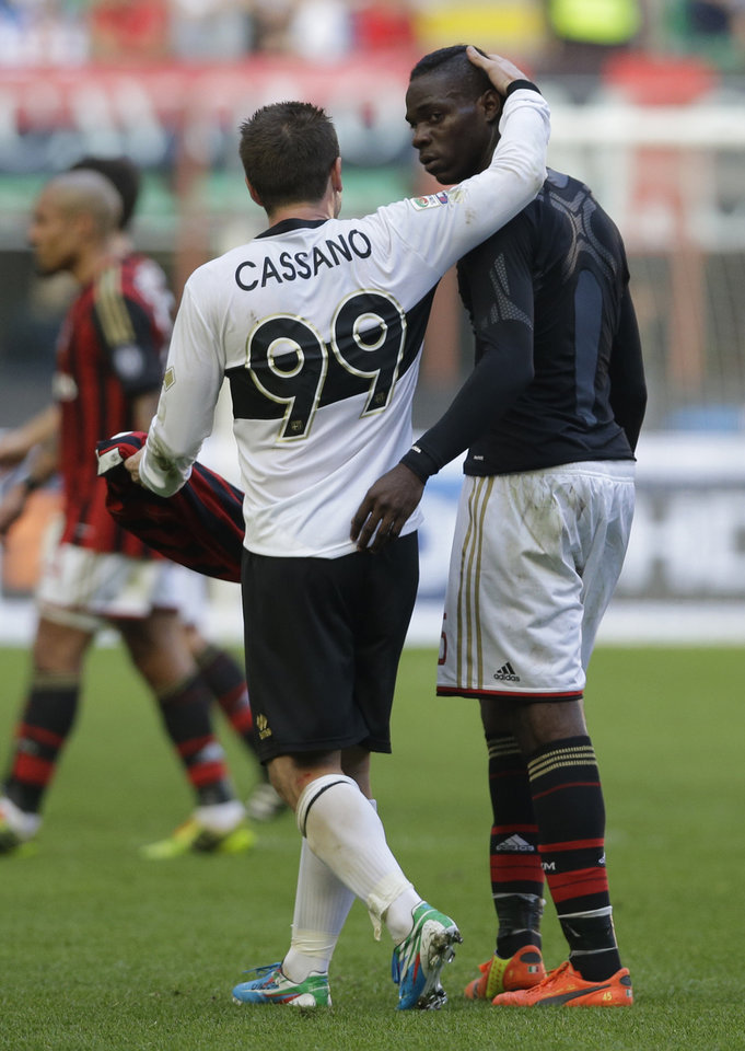 Photo - Parma forward Antonio Cassano, left, hugs AC Milan forward Mario Balotelli at the end of the first half time, during a Serie A soccer match between AC Milan and Parma, at the San Siro stadium in Milan, Italy, Sunday, March 16, 2014. (AP Photo/Luca Bruno)