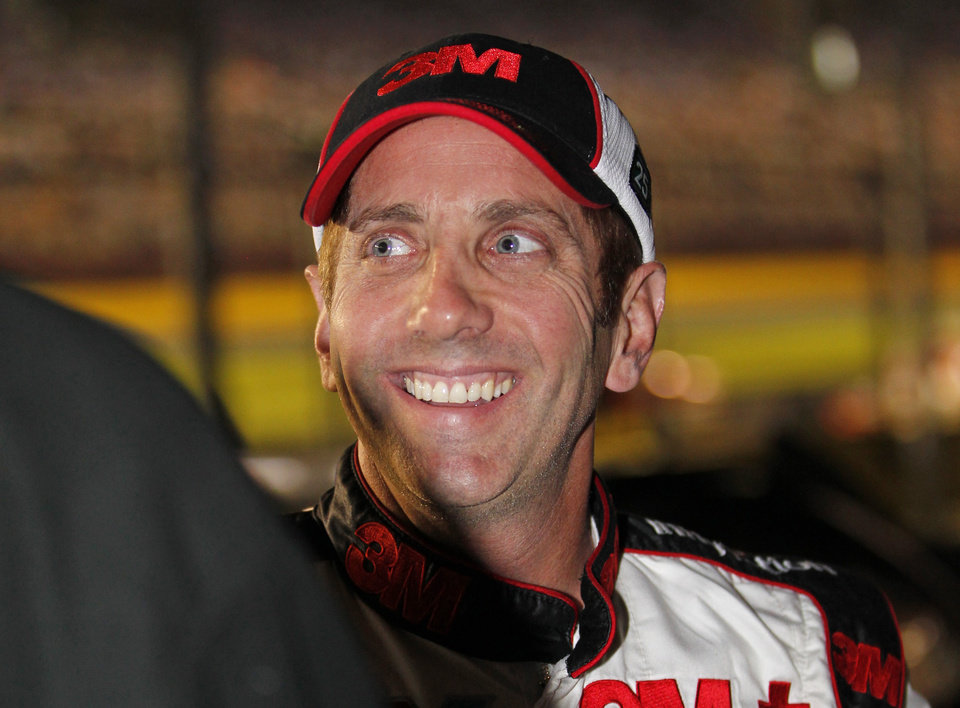 Photo -   Greg Biffle smiles after qualifying for Saturday's NASCAR Bank of America 500 Sprint Cup series auto race in Concord, N.C., Thursday, Oct. 11, 2012. Biffle won the pole position for the race. (AP Photo/Terry Renna)