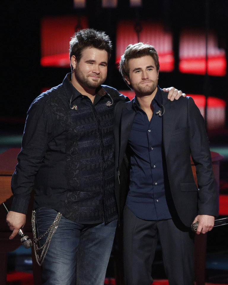 Photo - This June 17, 2013 image released by NBC shows Muskogee duo Zach Swon, left, and Colton Swon of The Swon Brothers, on stage during the singing competition series