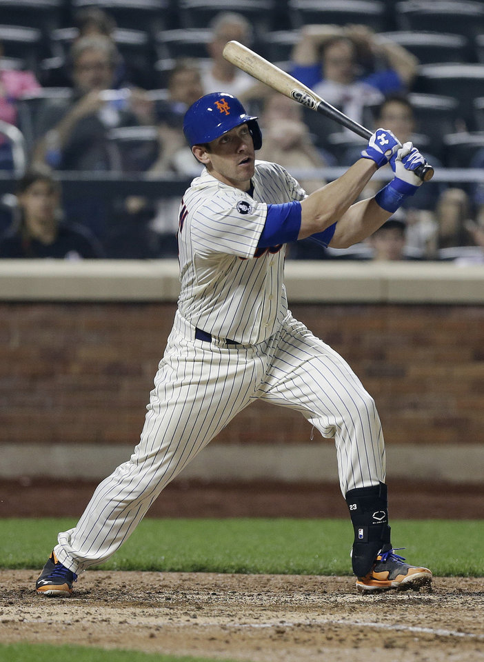 Photo - New York Mets' Taylor Teagarden follows through on a grand slam home run during the sixth inning of a baseball game Tuesday, June 10, 2014, in New York. (AP Photo/Frank Franklin II)
