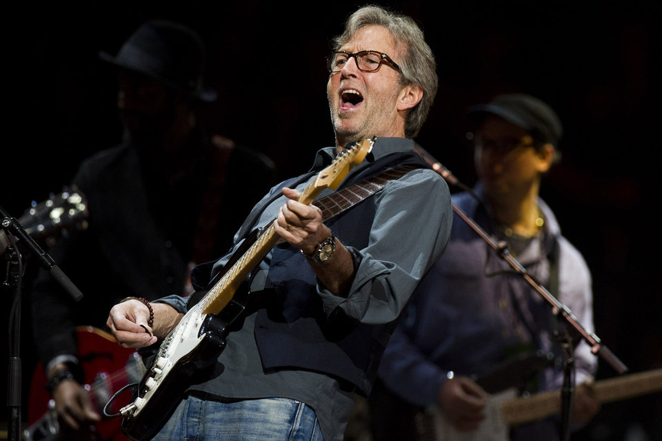 Photo - FILE - This April 14, 2013 file photo shows Eric Clapton performing at Eric Clapton's Crossroads Guitar Festival 2013 at Madison Square Garden in New York. Clapton says singer-songwriter JJ Cale rescued him and gave him a direction. Cale's music continues to inspire and push Clapton in powerful ways, something Clapton marks with the release this week of