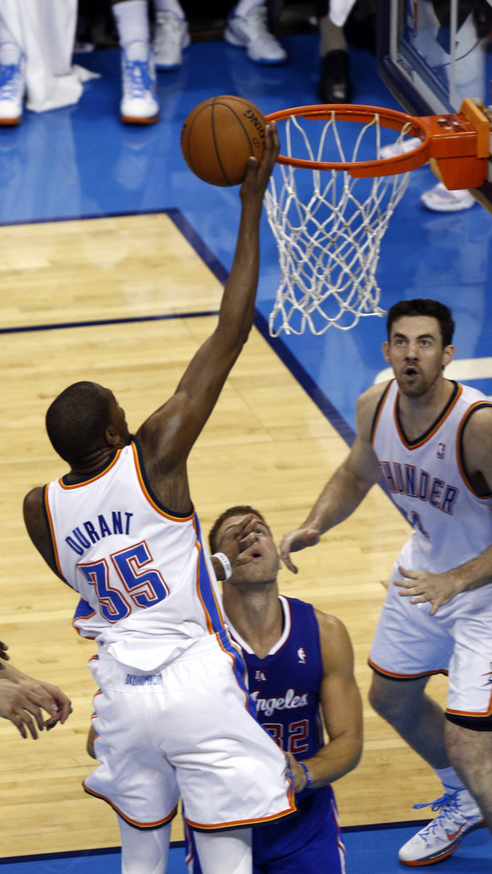 Photo - Oklahoma City's Kevin Durant (35) shoots over Los Angeles' Blake Griffin (32) during Game 2 of the Western Conference semifinals in the NBA playoffs between the Oklahoma City Thunder and the Los Angeles Clippers at Chesapeake Energy Arena in Oklahoma City, Wednesday, May 7, 2014. Photo by Sarah Phipps, The Oklahoman