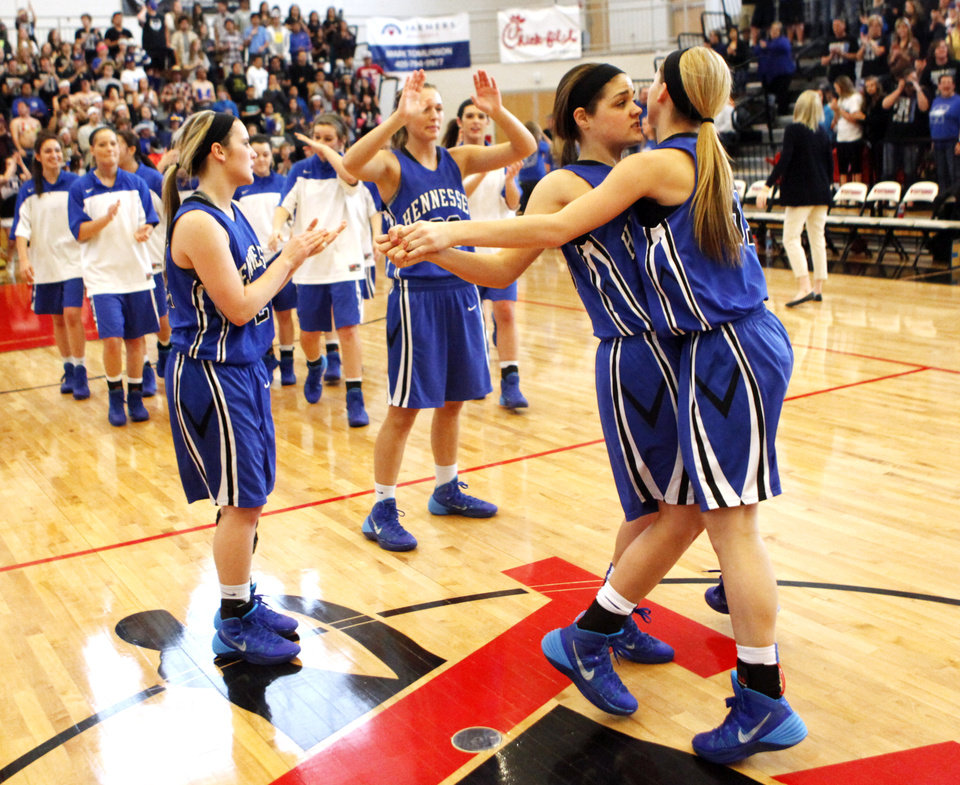 Photo - Hennessey guard Addi Meeker (20, left) hugs Kinsey Neiderer  (31, right) at mid court after being introduced before the 2A Girls quarterfinals game between Hennessey and Millwood at Westmoore High School on Thursday, March 13, 2014. Millwood defeated Hennessey 34-27. Photo by KT King, The Oklahoman
