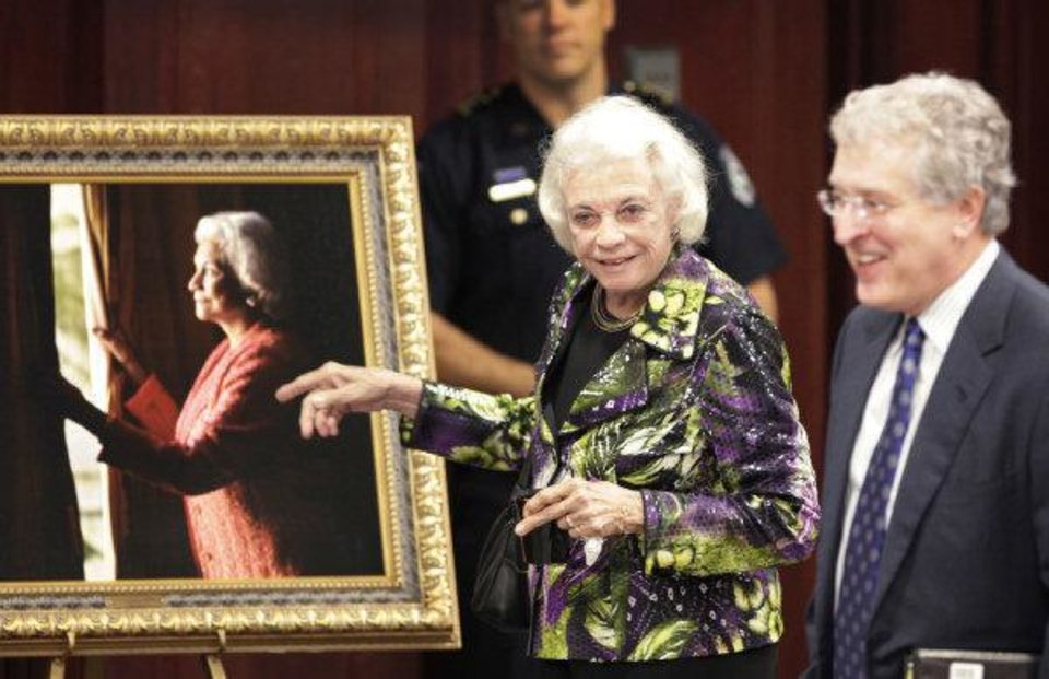 Photo - Retired Supreme Court Justice Sandra Day O'Connor comments on a portrait of herself to OCU President Robert Henry before she spoke to students, faculty and staff at OCU, Thursday, April 14, 2011.        Photo by David McDaniel, The Oklahoman  ORG XMIT: KOD