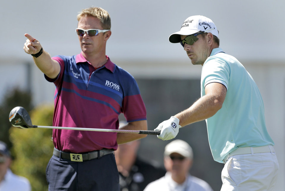 Photo - Henrick Stenston, of Sweden, right, points with his caddie Gareth Lord during a practice round for the Arnold Palmer Invitational golf tournament at Bay Hill, Wednesday, March 19, 2014, in Orlando, Fla. (AP Photo/Chris O'Meara)