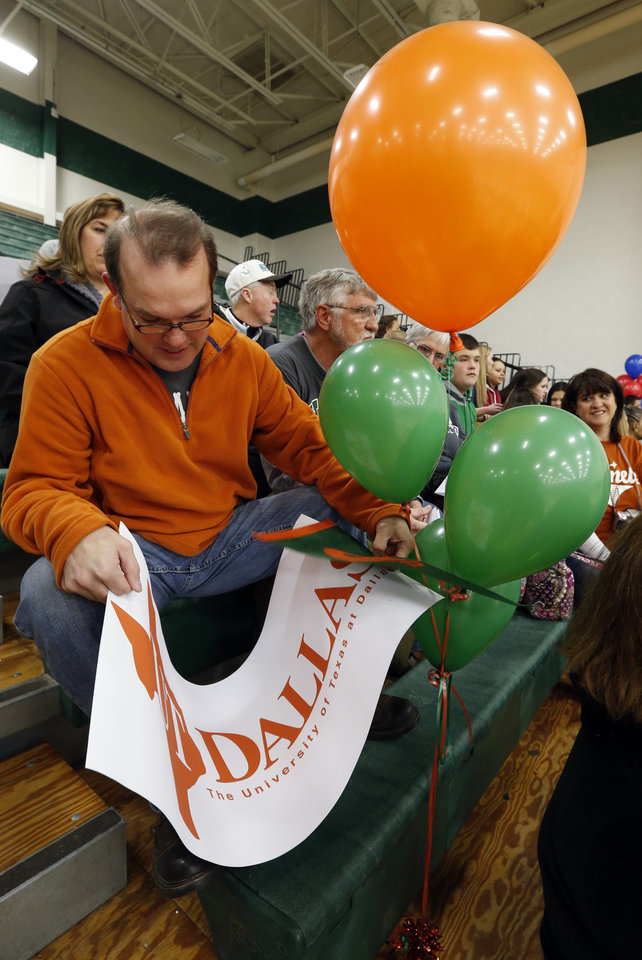 Photo - Michael Smith is equipped with balloons and banners to accompany his daughter Michaela's announcement to play softball for the University of Texas, Dallas at signing day ceremonies at Norman North High School on Wednesday, Feb. 5, 2014 in Norman, Okla.  Photo by Steve Sisney, The Oklahoman