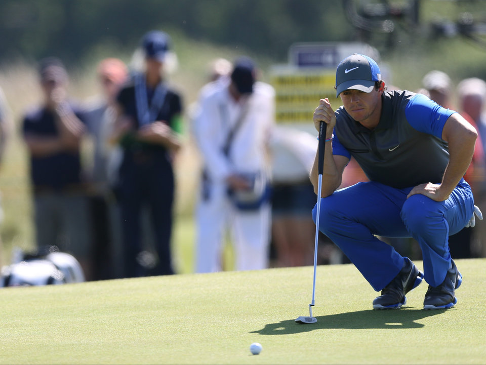 Photo - Rory McIlroy of Northern Ireland lines up a putt on the 5th green during the first day of the British Open Golf championship at the Royal Liverpool golf club, Hoylake, England, Thursday July 17, 2014. (AP Photo/Scott Heppell)