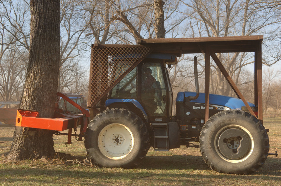 A shaker clamps a pecan tree during the harvest at the Flying G Ranch near Sand Springs. PHOTO PROVIDED BY MIKE SPRADLING