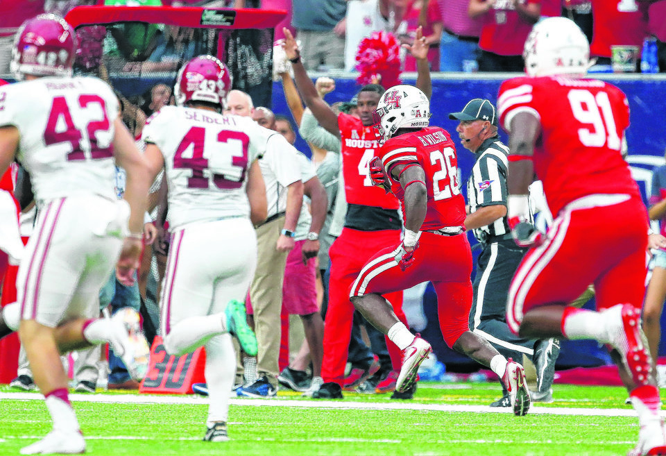 Photo -  Houston's Brandon Wilson returns a missed field goal 100 yards for a touchdown during Saturday's win over OU at NRG Stadium in Houston. [Photo by Bryan Terry, The Oklahoman]