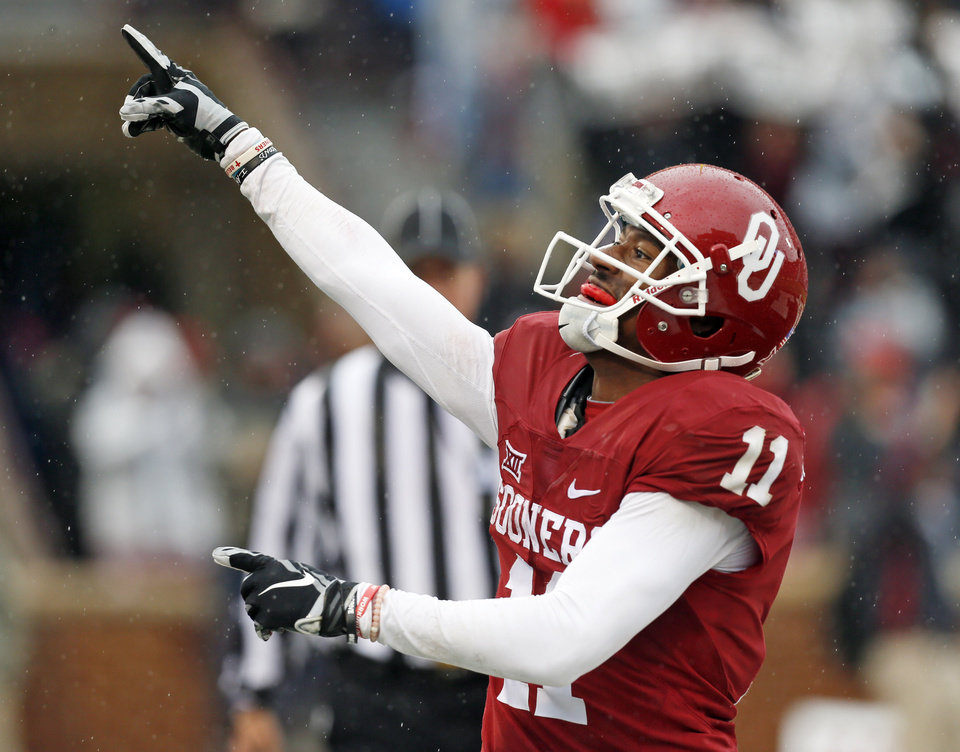 Photo - Oklahoma's Dede Westbrook (11) celebrates a touchdown in the second quarter during the Bedlam college football game between the Oklahoma Sooners (OU) and the Oklahoma State Cowboys (OSU) at Gaylord Family - Oklahoma Memorial Stadium in Norman, Okla., Saturday, Dec. 3, 2016. Photo by Nate Billings, The Oklahoman