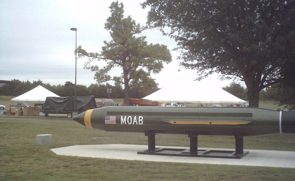 "A replica of the ""Mother Of All Bombs"" produced at the McAlester Army Ammunition Plant is in front of the area of a community yard sale and Patriot Run registration."