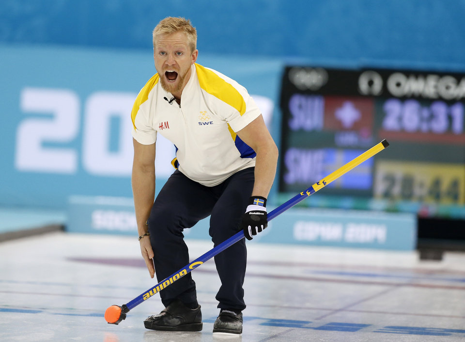 Photo - Sweden's skip Niklas Edin shouts instructions after delivering the rock in men's curling competition against Switzerland at the 2014 Winter Olympics, Monday, Feb. 10, 2014, in Sochi, Russia. (AP Photo/Robert F. Bukaty)