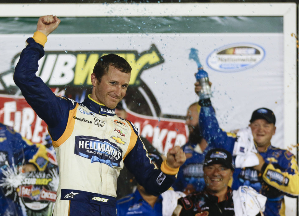 Photo - Kasey Kahne celebrates in Victory Lane after winning the NASCAR Nationwide series auto race at Daytona International Speedway in Daytona Beach, Fla., Friday, July 4, 2014. (AP Photo/John Raoux)