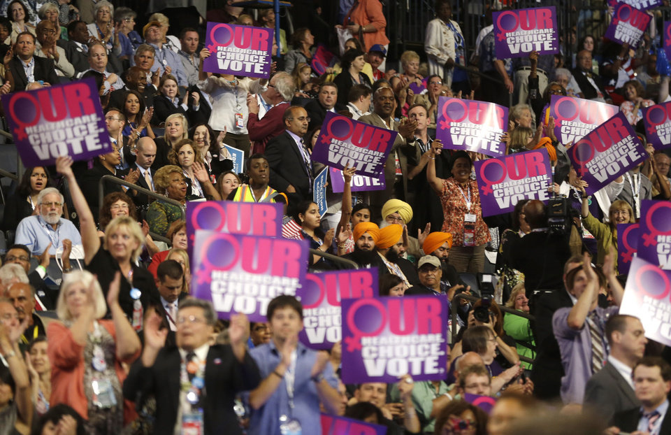 Photo - Delegates cheer as President of Planned Parenthood Action Fund Cecile Richards addresses the Democratic National Convention in Charlotte, N.C., on Wednesday, Sept. 5, 2012. (AP Photo/Charles Dharapak)  ORG XMIT: DNC754