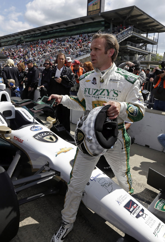 Photo - Ed Carpenter steps over his car after he qualified on the first day of qualifications for Indianapolis 500 IndyCar auto race at the Indianapolis Motor Speedway in Indianapolis, Saturday, May 17, 2014. (AP Photo/Darron Cummings)