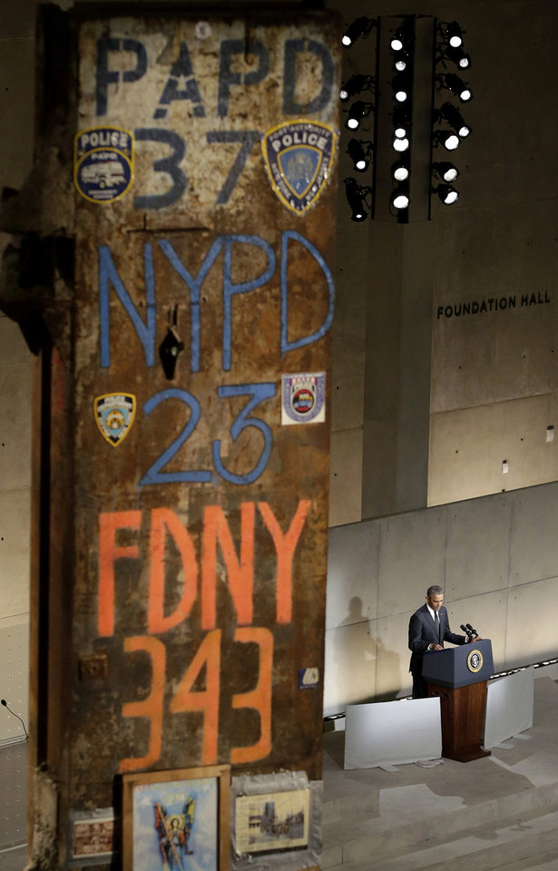 Photo - President Barack Obama speaks at the dedication ceremony for the National September 11 Memorial Museum on Thursday, May 15, 2014 in New York.  (AP Photo/John Angelillo, Pool)
