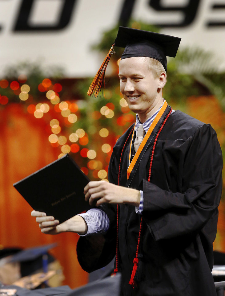 Undergraduates at OSU participated in the school's 127th commencement ceremony the weekend of Friday, May 3 and Saturday, May 4, 2013 inside Gallagher-Iba Arena on the university's campus.These photos were taken at the Saturday morning ceremony when students from the College of Agricultural Sciences and Natural Resources, and the Spears School of Business were conferred with degrees.   Photo  by Jim Beckel, The Oklahoman.