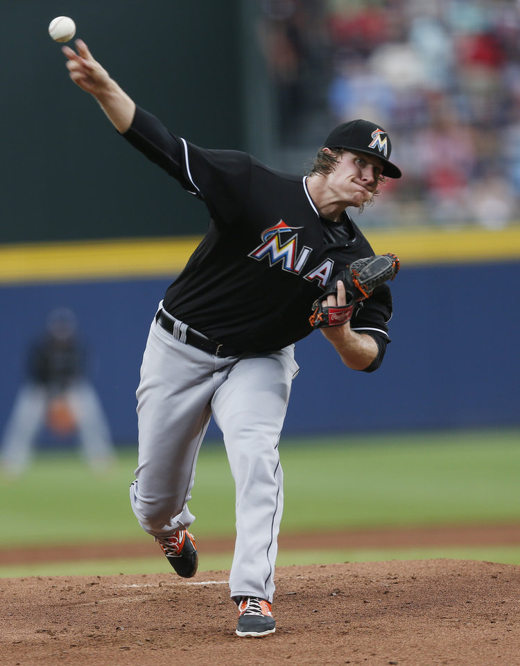 Photo - Miami Marlins starting pitcher Tom Koehler (34) works in the first inning of a baseball game against the Atlanta Braves  in Atlanta, Monday, July 21, 2014. (AP Photo/John Bazemore)