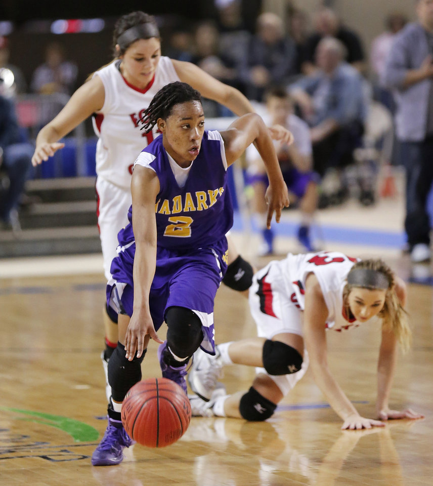 Photo - Anadarko player Tandra King dribbles ahead of two Ft. Gibson players during the Class 4A State championship game between Ft. Gibson and Anadarko at Jim Norick Arena at State Fair Park  on Saturday, Mar. 15, 2014. Ft. Gibson came from behind much of the second half to win 50-47.  Photo by Jim Beckel, The Oklahoman
