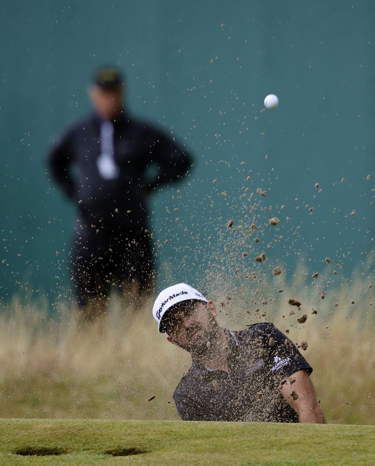 Photo - Rhein Gibson of Australia plays out of the bunker on the 18th hole during the third day of the British Open Golf championship at the Royal Liverpool golf club, Hoylake, England, Saturday July 19, 2014. (AP Photo/Alastair Grant)