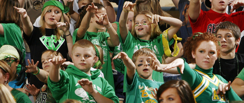 Photo - Adair fans hold out their hands during a foul shot in the 3A girls semifinal game between Marietta and Adair in the Oklahoma High School Basketball Championships at State Fair Arena in Oklahoma City, Friday, March 13, 2009. Adair won, 55-50. PHOTO BY NATE BILLINGS, THE OKLAHOMAN