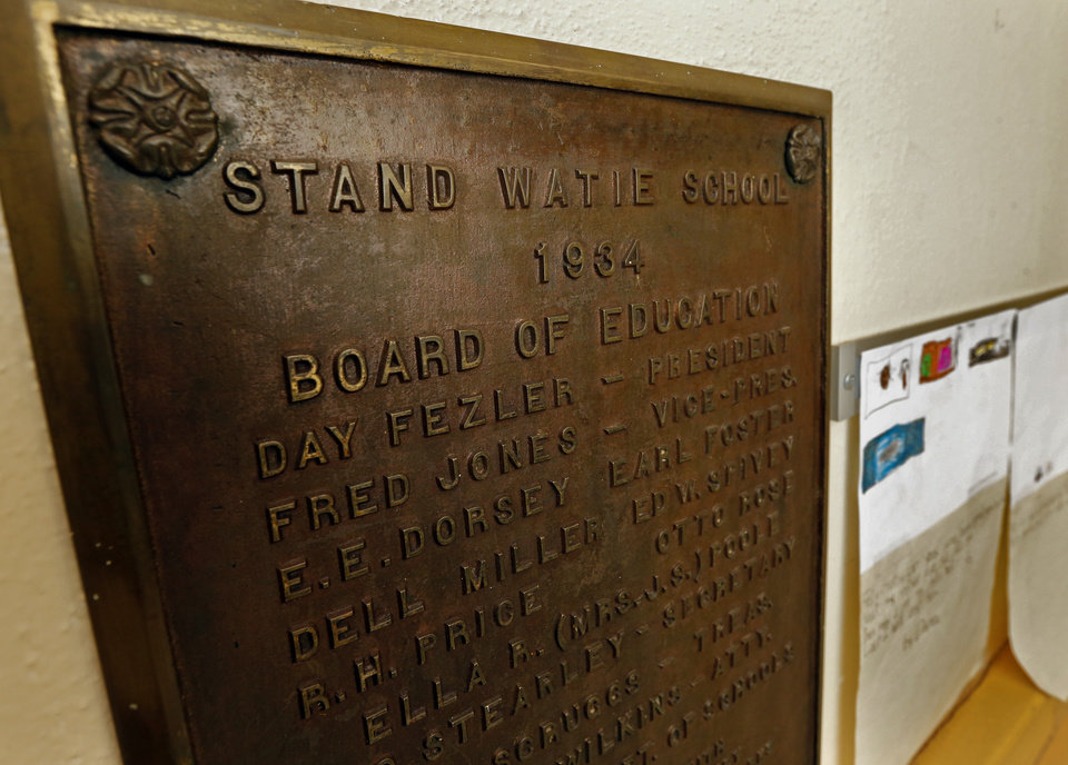 Photo -  A plaque hangs in the hall of Stand Watie Elementary School in Oklahoma City. [Photo by Steve Sisney, The Oklahoman]