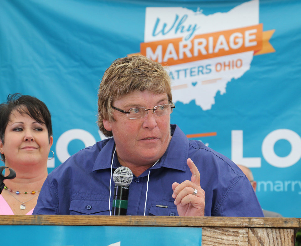 Photo - Gay marriage supporter Kim Franklin, speaks to supporters of gay marriage during a rally in downtown Cincinnati on Tuesday, Aug. 5, 2014. Franklin is one of the plaintiffs for a case being argued before the 6th U.S. Circuit Court of Appeals in Cincinnati on Wednesday. (AP Photo/Tom Uhlman)