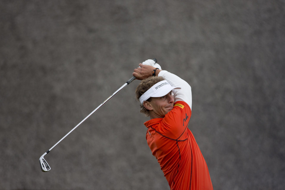 Photo - Netherlands' Joost Luiten tees off on hole one during the final round of the KLM Open men's golf tournament in the beach resort of Zandvoort, western Netherlands, Sunday, Sept. 15, 2013. (AP Photo/Peter Dejong)