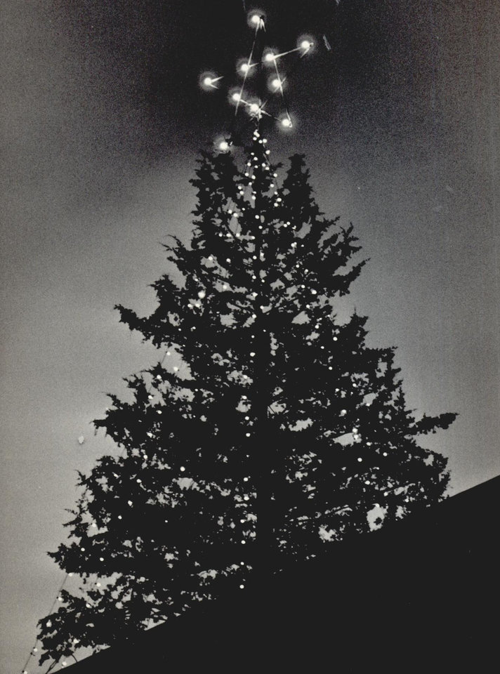 Photo - The newly constructed Myriad Convention Center is topped off with a Christmas tree in 1970. [Photo by Bob Albright, The Oklahoman Archives]